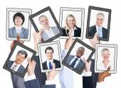 Business People on tablets screens — Stock Photo