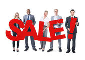 Business People Holding word sale — Stock fotografie