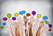 People's Hands Raised with Speech Bubbles — Stock Photo