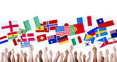 People Holding National Flags — Stock Photo