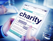Man Reading the Definition of Charity — Stock Photo