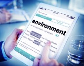 Man Reading the Definition of Environment — Stock Photo