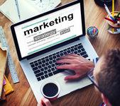 Man reading definition of Marketing — Stock Photo