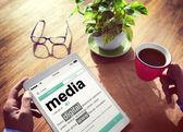 Man reading definition of media — Stock Photo