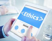 Businessman holding tablet with Ethics Concept — Stock Photo