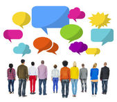 People Facing Backwards with Speech Bubbles — Stock Photo