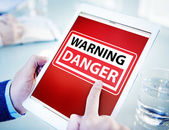 Hands Holding Tablet with Danger — Stock Photo