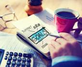 Businessman Writing Goals Concept — Stockfoto