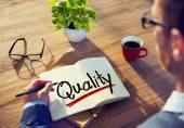Man with and Single Word Quality — Stock Photo