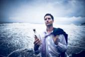 Businessman with Message in Bottle — Stock Photo