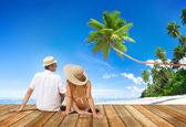 Couple on Wooden Floor at Beach — Stock Photo