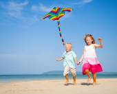 Sibling playing on beach — Stock Photo