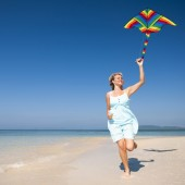 Woman relaxing on a tropical beach — Stock Photo