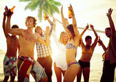 Young People Celebrating by the Beach — Stock Photo