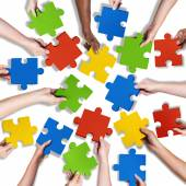 Diverse Hands Holding Jigsaw Puzzle — Stock Photo