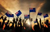 People Holding Flags of New Zealand — Stock Photo