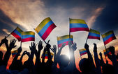People Waving Columbian Flags — Stock Photo