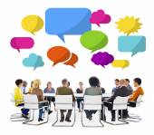 Group in Meeting with Speech Bubbles — Stock Photo