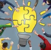 People with Light Bulb Jigsaw Symbol — Stock Photo