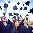 Graduation Caps Thrown in the Air — Stock Photo #63024457