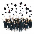 Graduation Caps Thrown in the Air — Stock Photo #63024555