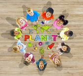 Children in Circle with Planet Message — Stock Photo