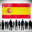 Spanish flag and business people — Stockfoto #63031405