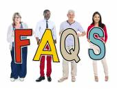 People Holding FAQS word — Stock Photo