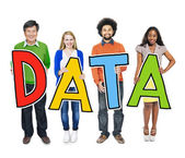People Holding Word Data — Stock Photo