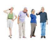 Senior adult using communication devices — Stock Photo