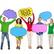 People Holding Colorful Speech Bubbles — Stock Photo #63062211