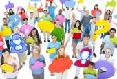 People holding colorful speech bubbles — Stock Photo