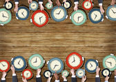People's Hands Holding Clocks — Stock Photo