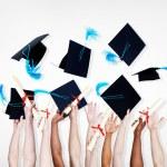 Hands Holding Diplomas — Stock Photo #63075005