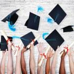 Hands Holding Diplomas — Stock Photo #63075067