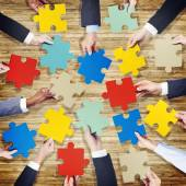 Hands Holding Jigsaw Pieces — Stock Photo