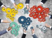 Business People Holding Gears — Stock Photo