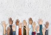 Diverse Hands Raised — Stock Photo