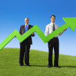 Two Businessmen holding increase graph — Stock Photo #63086869