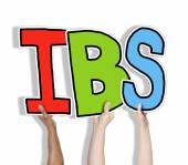 Hands holding IBS letters — Stock Photo