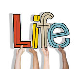 Hands holding word 'life' — Stock Photo