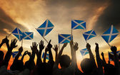 People Waving Scottish Flags — Stock Photo