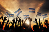 People Holding Flags of Argentina — Stock Photo
