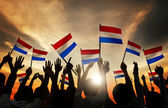 People Holding Flags of Netherlands — Stock Photo