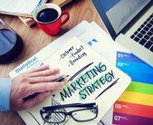 商人写的营销策略 — 图库照片