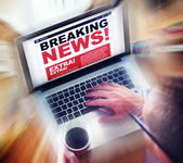 Man using laptop with Breaking News — Stock Photo
