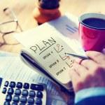 Man Writing Plan in Note Pad — Stock Photo #63102295