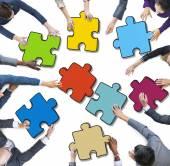 People Holding Jigsaw Puzzle — Stock Photo