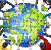 People with Jigsaw Puzzle Forming Globe — Stock Photo