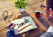 Businessman writting Donate — Stock Photo